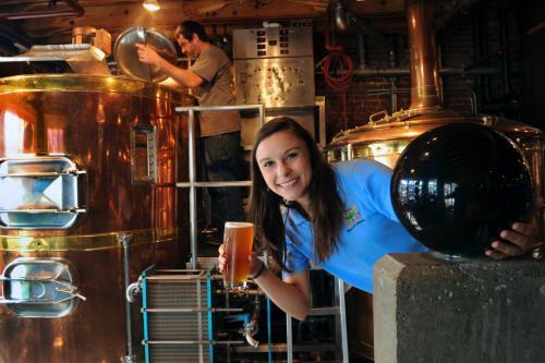 Carolina Brewery Jessy Reynolds Holds A Brew