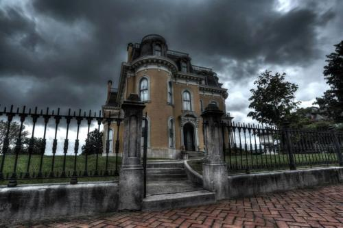 Exterior of the Culbertson Mansion with a dark, cloudy sky