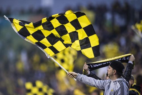 Crew SC fan waving a flag