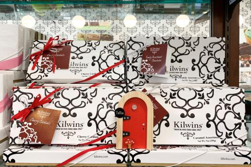 Red Fairy Door in front of Kilwins chocolate boxes