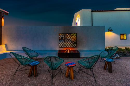 Chairs encircle an outdoor fireplace at Texican Court.