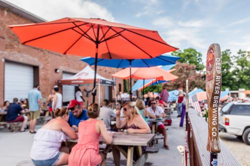 People on the outside patio at Deep River Brewery in Clayton NC.