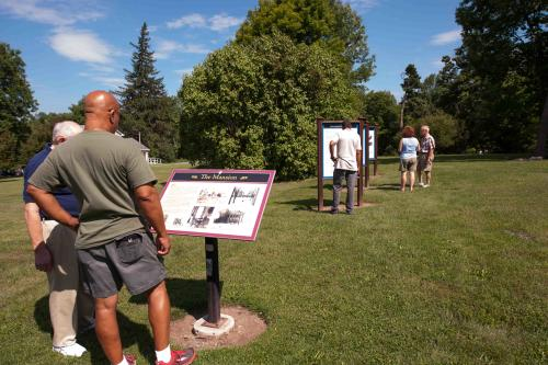 Reading signs at Gerrit Smith Estate National Historic Landmark