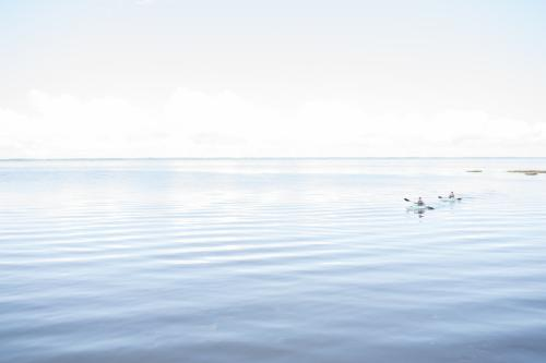 Visitors enjoy the calm waters as they kayak through the sound-side of the Outer Banks islands.