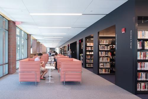 A reading section with pink lounge chairs in the Princeton Public Library