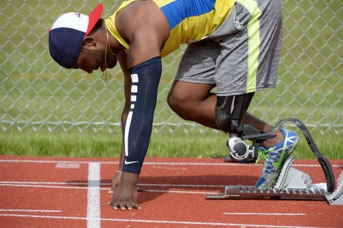 Adaptive Runner Prepares to Start Race Disabled Sports US