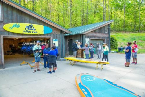 People renting paddle boards at High Country Outfitters Paddle Shack