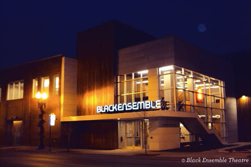 Street view of Black Ensemble Theatre at night with moon in the background
