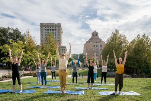Explore downtown Asheville with a yoga tour provied by Asheville Wellness Tours