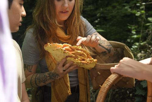 Woman holding a large mushroom