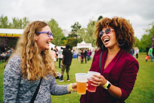 Two Friends Enjoying Libations at Rochester Lilac Festival