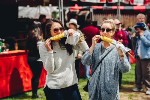 Two Guests Eating Corn on the Cob at the Rochester Lilac Festival