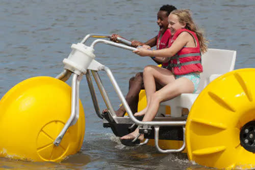 Two girls on a water trike