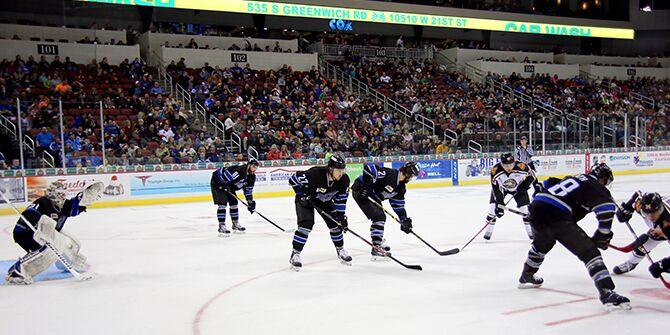 The Wichita Thunder hockey team face off on the ice at INTRUST Bank Arena in Wichita