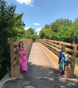 The Red Maple Path bridge offers creek views!