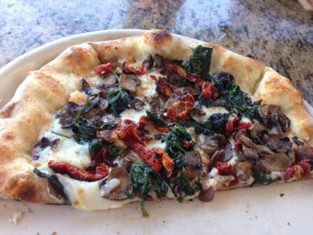 Spinach, sun-dried tomato, and goat cheese pizza from Huntington Beach Beer Co. (Photo courtesy of Robbin G. / Yelp)