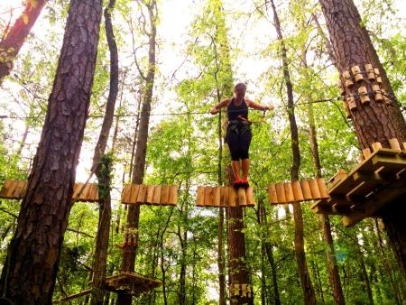 Girl on logs at treetop quest