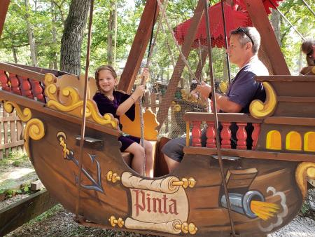 Ship ride at Bristol Renaissance Faire with two riders