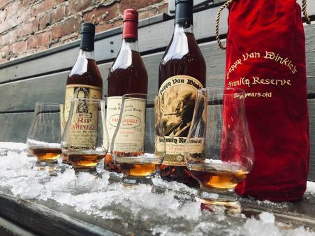 photo of bottles of van winkle bourbon lined up in the snow