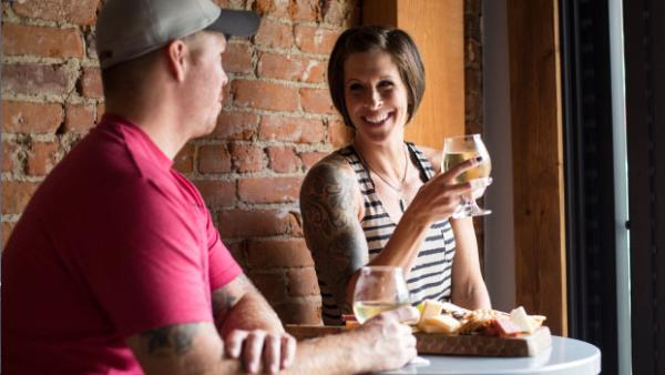 Couple enjoying South Shore Winery and cheeses