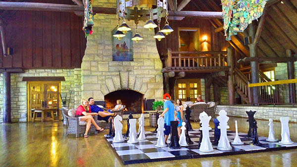 Family on Vacation Playing Chess on Large Chessboard