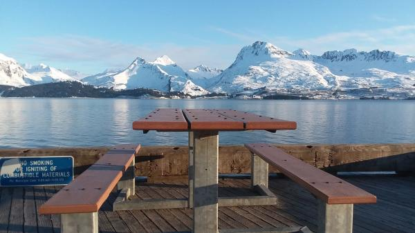 a picnic table at a dock