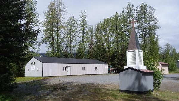 a church in a small town. Trees in background