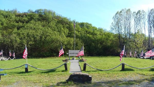 A memorial park with American flags