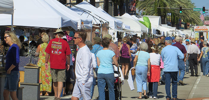 Halifax Art Festival goers stroll along the many tents on Beach Street.