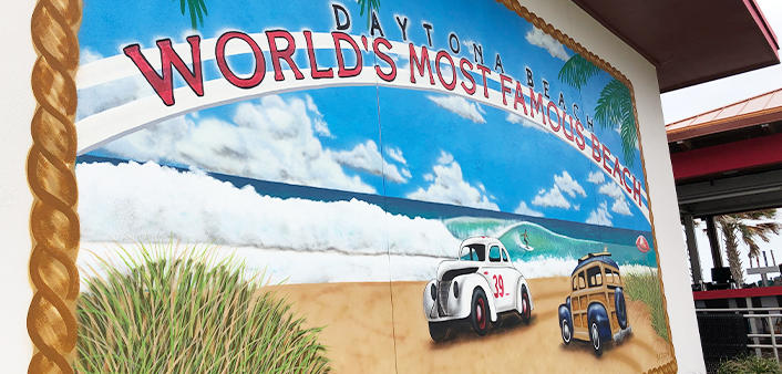 The World's Most Famous Beach mural at Crabby's Oceanside restaurant