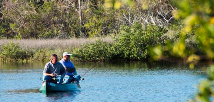 Two fishermen canoeing the inland waterways of Daytona Beach