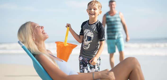 A family enjoys beach time together in Daytona Beach