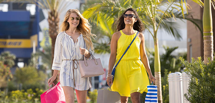 Two women stroll One Daytona while shopping