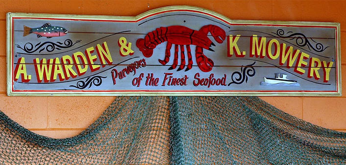 A decorative sign with netting at Our Deck Down Under