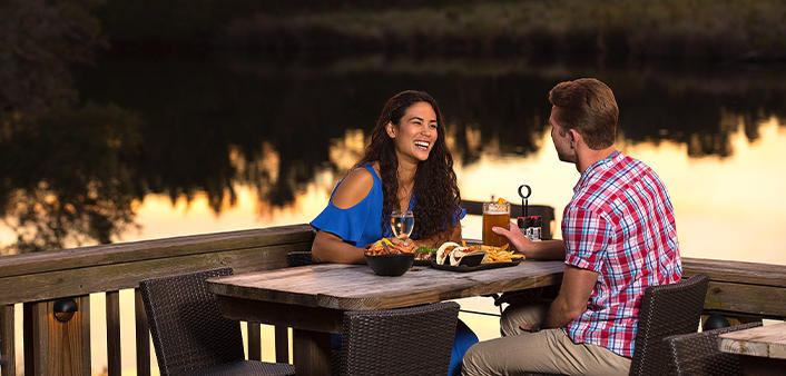 A couple is enjoying a sunset dinner on the Tomoka River