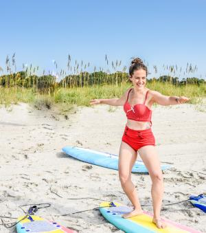 Lady learns to surf in Myrtle Beach