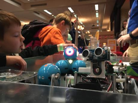 Boy and robot at Rochester Makers Fair