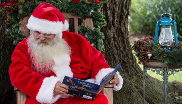 Santa Claus reading a book at George Ranch Historical Park.