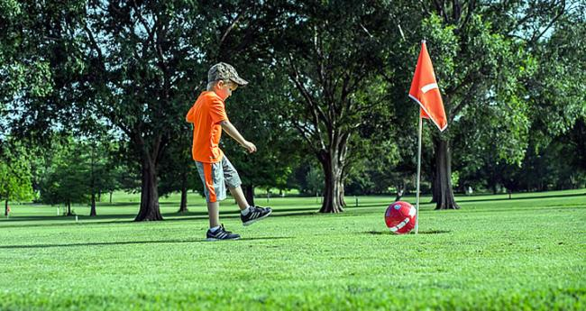 Boy playing Foot Golf