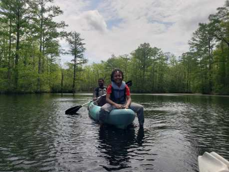 Child on End of Kayak with Father