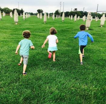 Kids running through the field of corn