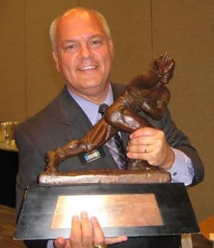 Brian Timm with Heisman Trophy
