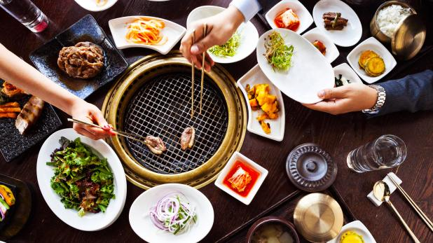 Korean barbecue cooked perfectly on a grill right on your table
