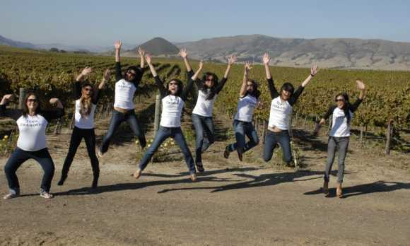 girls jumping in vineyard.jpg