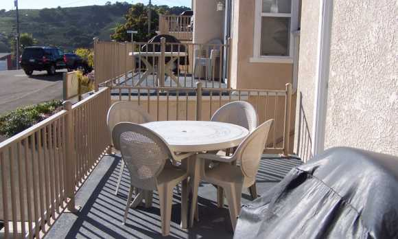 Deck with gas grill & patio table with chairs.JPG