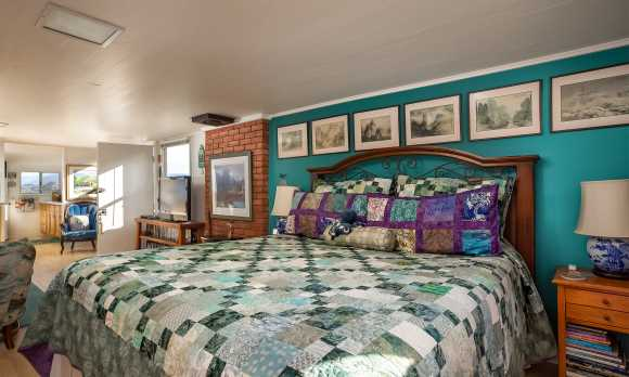 Great room includes a king-size bed and hand-made quilt