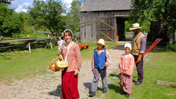 Family Dressed in Old Timely Clothes at Genesee Country Village & Museum in NY