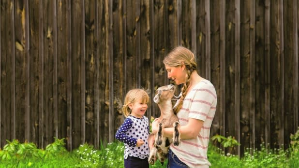 Family Holding A Goat at Sprout Creek Farm