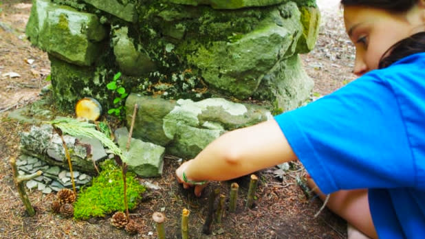 Girl digging in ground at 61st Annual Allegany Nature Pilgrimage