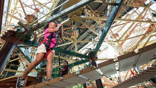 Young girl climbing on the Canyon Climb Adventures at WonderWorks in Destiny USA Mall